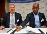 Afrox MD Brett Kimber signs a R300m investment deal with the Coega Development Corporation's executive manager Christopher Mashigo for the establishment of the 150-ton air separation unit in Zone 3 of the Coega industrial development zone.