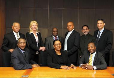 Standing left to right: Eltie Links; Brigitte de Bruyn (Financial Director); Hosia Malekane; Masimo Magerman; Younaid Waja; Brian Azizollahoff. Sitting front left to right: Saul Gumede (Executive Director); Chairman Zanele Matlala and CEO Izak Petersen.