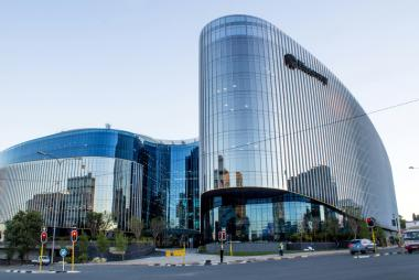 "Discovery Group pays R23 million a month to rent its plush global headquarters in Sandton. The building is considered to be ""the largest single-phase commercial office development in Africa."""