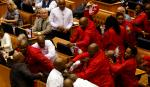 Fitch Ratings holds off on downgrading South Africa's credit rating at investment grade but warned that political and growth concerns posed a risk. [IMAGE] EFF MPs fight with security services who were ordered to throw them out of parliament recently