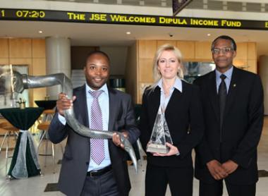 Izak Petersen (CEO of Dipula Income Fund), Brigitte de Bruyn (Financial Director, Dipula Income Fund) and Saul Gumede (Director, Dipula Income Fund) celebrate the listing of Dipula Income Fund on the JSE.