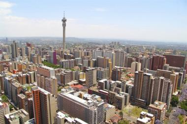 Integrated Urban Development Framework (IUDF) aims to develop and create vibrant spaces that are geared towards inclusive living and growth in the country's towns and cities. [A view of the Johannesburg skyline]