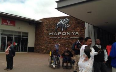 Shoppers waiting outside Maponya Mall in Soweto, where an attempted armed robbery took place inside Pick n Pay on 17 December 2014. Picture: Masego Rahlaga/EWN.