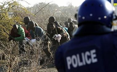 Marikana Massacre: Striking miners at the Lonmin platinum mine in Marikana area. Increased labour strikes and high unemployment levels has caused the IMF to downgrade South Africa's growth forecast.