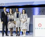 Neil Gopal, Amelia Beattie Nontokozo Nene and Pamela Snyman share a moment after the bursary announcement at the annual SAPOA International Convention and Property Exhibition in Durban.