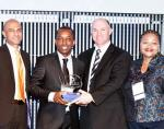 On behalf SA Commercial Prop News, Media Director Ortneil Kutama accepts the prestigious SAPOA Journalism Award for best Online News Coverage Category.
