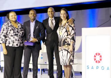 SA Commercial Prop News Media Director, Ortneil Kutama accepts the prestigious SAPOA Journalism Award for best Online News Coverage Category — 4th time in a row.