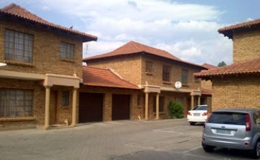 Two-bedroom apartments for sale in Die Bult, Potchefstroom, close to the North West University, for around R675 000 each. The apartments each have a garage and a parking bay, and monthly levy is currently R345 for this complex