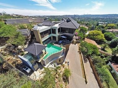 A four-storey designer mansion in the heart of Bedfordview belonging to Czech fugitive Radovan Krejcir was sold at an auction on Saturday morning.