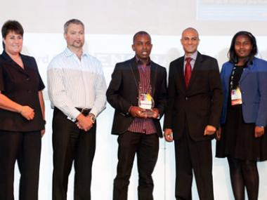 SA Commercial Prop News retains the crown for the second year in a row, winning the SAPOA Property Online News Portal of the Year Accolade. Ortneil Kutama Media Director at SA Commercial Prop News seen with the Award.