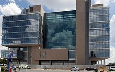 "Standard Bank to takes up residence in its news green building in Rosebank which has received a five-star rating for ""green"" design from the Green Building Council of SA."