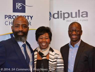 Property Sector Charter Council commit members, Musa Ngcobo, Portia Tau-Sekati, CEO of the Council and Mashilo Pipjeng share a moment during the anouncement of the research media brief held at the Davinci Hotel Johannesburg.
