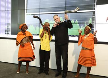 Stephen Brookes, CEO of Balwin Properties Limited sounding the kudu horn at the JSE listing event.