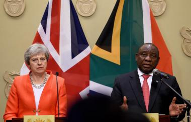 British Prime Minister Theresa May addressing a business leaders forum in with South Africa's President Cyril Ramaphosa
